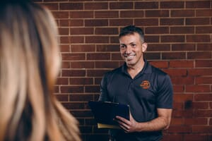 fire damage technician talking to a customer