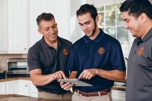 911 restoration team in kitchen