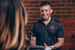 911 restoration technician talking to customer